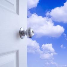 Door opening onto blue sky