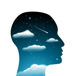 Outline of human head filled with drak blue sky, clouds, comets and stars