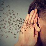 Letters flowing into listening man's ear