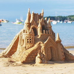 Castle Made of Sand with ocean approaching